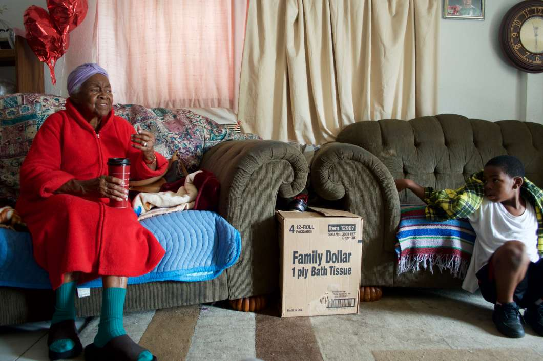 Ms. Emma with her grandson at their home in Eatonville. Photo: Black Florida, Johanne Rahaman.