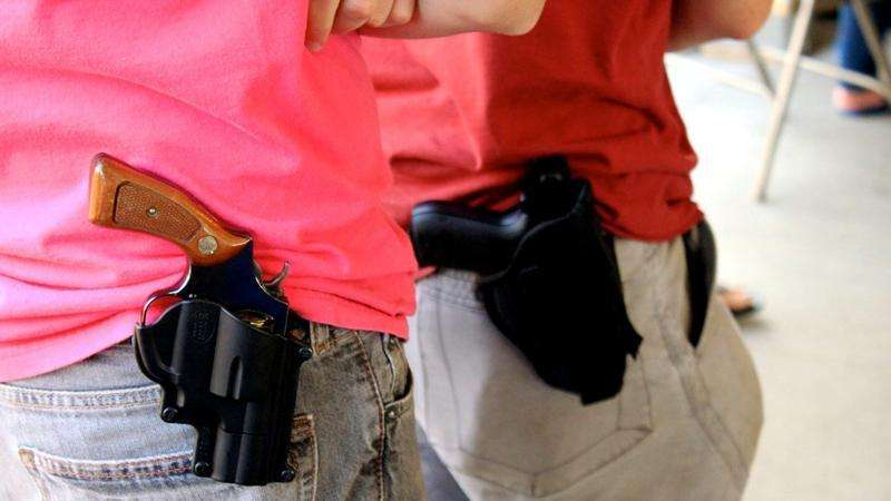 Two people with open carry weapon on hip