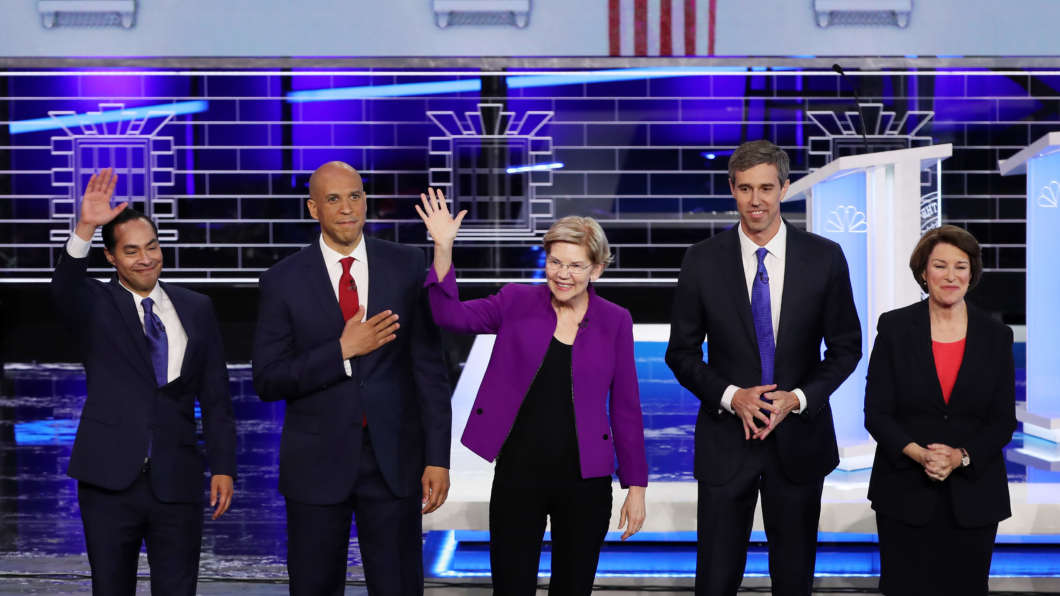 On Wednesday in Miami, Democratic presidential candidates take the stage during the first night of the Democratic presidential debate. From left: former Housing and Urban Development Secretary Julián Castro, New Jersey Sen. Cory Booker, Massachusetts Sen. Elizabeth Warren, former Texas Rep. Beto O'Rourke and Sen. Amy Klobuchar of Minnesota.