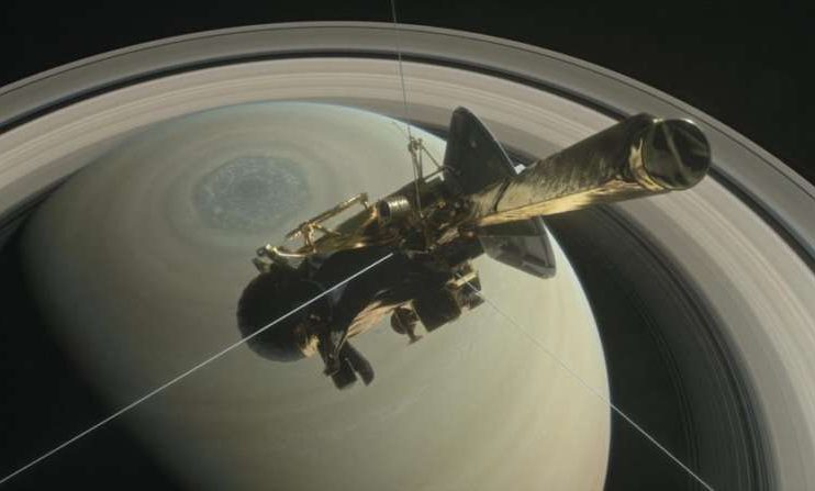 "This illustration shows NASA's Cassini above Saturn's northern hemisphere before making one of its ""Grand Finale"" dives."