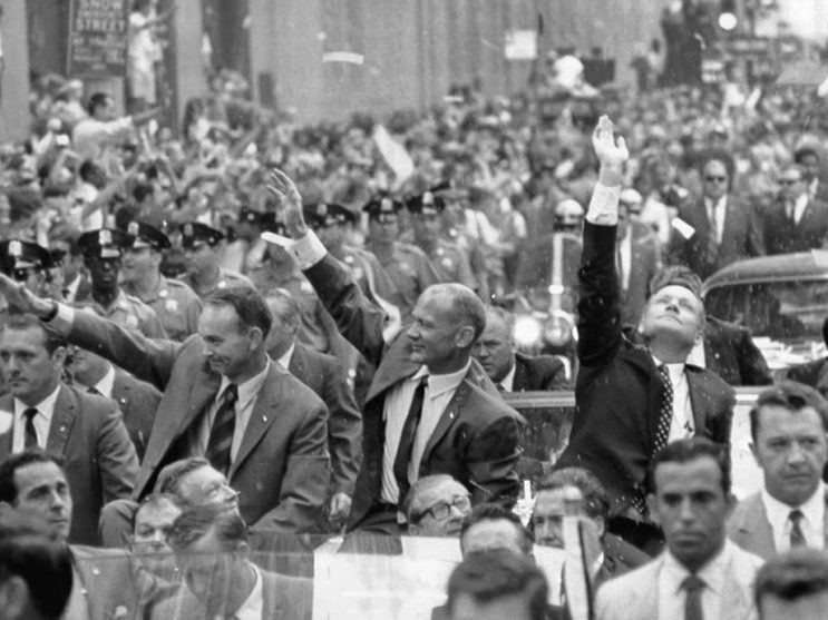"Edwin ""Buzz"" Aldrin, Michael Collins and Neil Armstrong are celebrated with a parade in New York City."