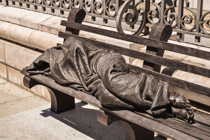 """A statue called """"Homeless Jesus"""" rests on Jackson Street in downtown Orlando. The work was commissioned by First Presbyterian Church of Orlando and created by Canadian artist Timothy Schmalz. Image courtesy of Flickr Creative Commons"""