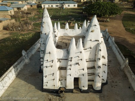 nakore mosque in upper west region ghana. sky view white spiked mosque