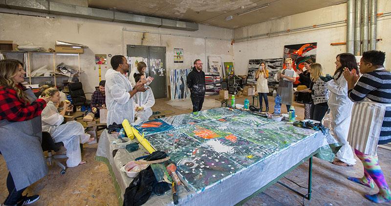 IMAGE: Designers standing around the canvas