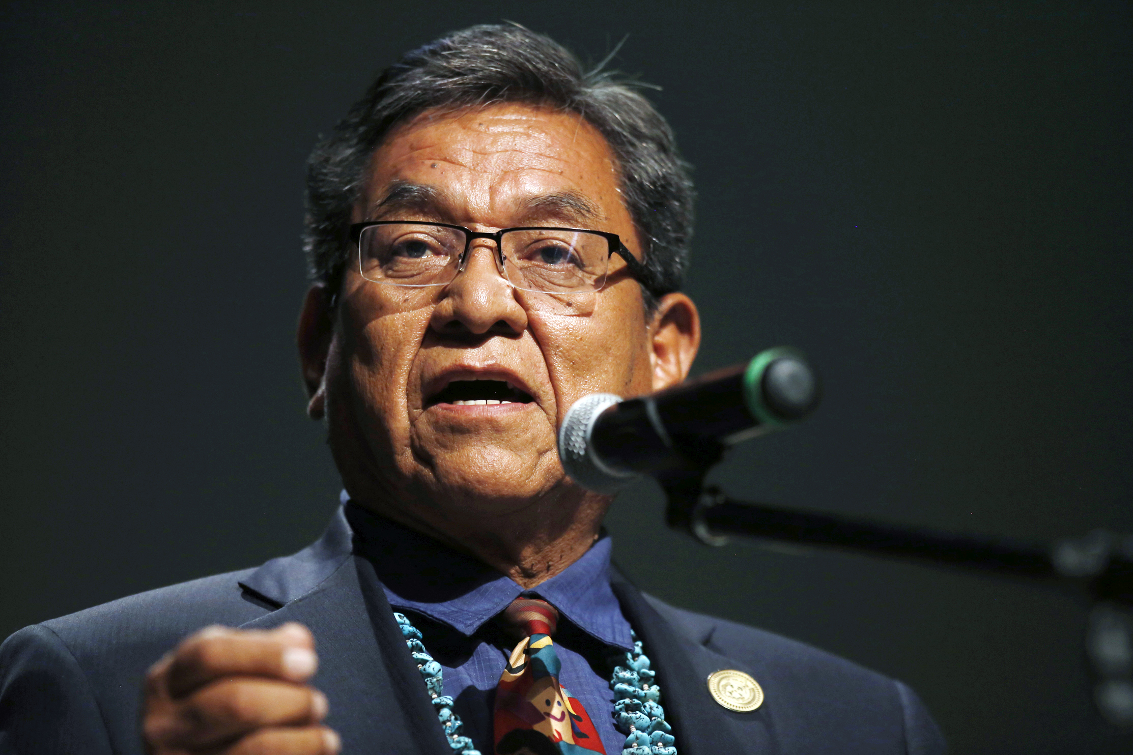 In this July 20, 2015 file photo, Navajo Nation President Russell Begaye talks with community members during a public meeting in Shiprock, N.M. The top two leaders on the Navajo Nation say recent suicides in communities affected by a mine spill have shaken reservation towns to their core. (Jon Austria/The Daily Times via AP, File) MANDATORY CREDIT