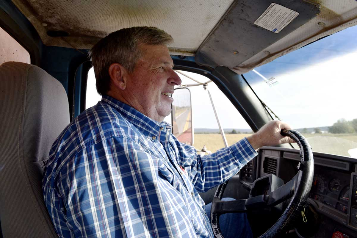 Earl Shero drives a feed truck through a pasture on his ranch in Wilburton. Shero believes that warmer temperatures in Oklahoma are caused by climate change.
