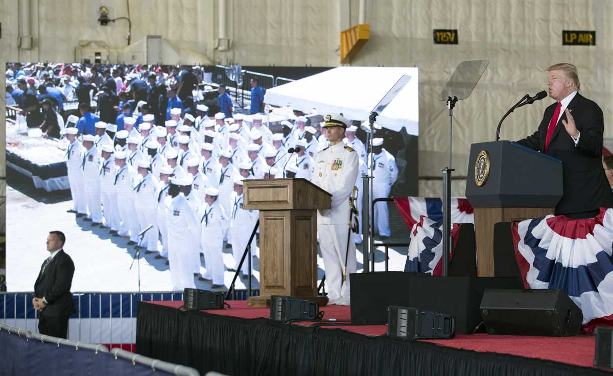 Caption: President Donald Trump speaks during the commissioning ceremony of the aircraft carrier USS Gerald R. Ford at Naval Station Norfolk on July, 22, 2017. (AP Photo/Carolyn Kaster)
