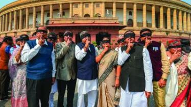 Trinamul Congress leaders protest over Delhi violence at Parliament during the ongoing Budget Session in New Delhi on Monday. (Photo: PTI)