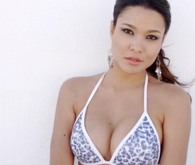 Sexy Girl In Bikini Top Posing Against White Wall By Daniel_dash Videohive