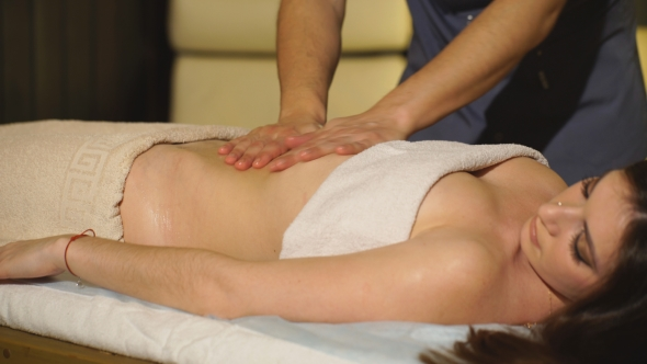 Girl Doing Abdominal Massage With Oil Stock Footage