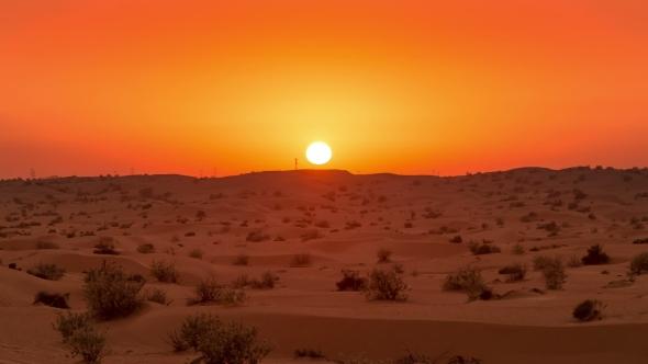 Golden Sunset Over The Desert Landscape In United Arab
