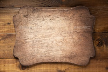 retro sign board at brown wooden background texture Stock Photo by seregam