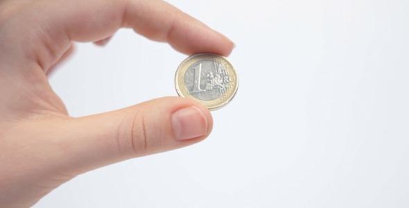 Female Hand Holding 1 Euro Coin By Vintervarg