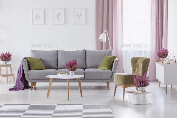 green cushions living room grey paint colors settee with and purple blanket in real photo stock images