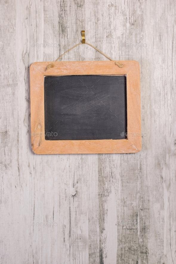 a wooden framed chalkboard