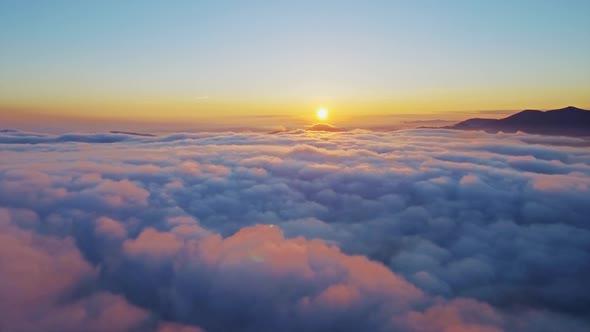 sunset flight above clouds