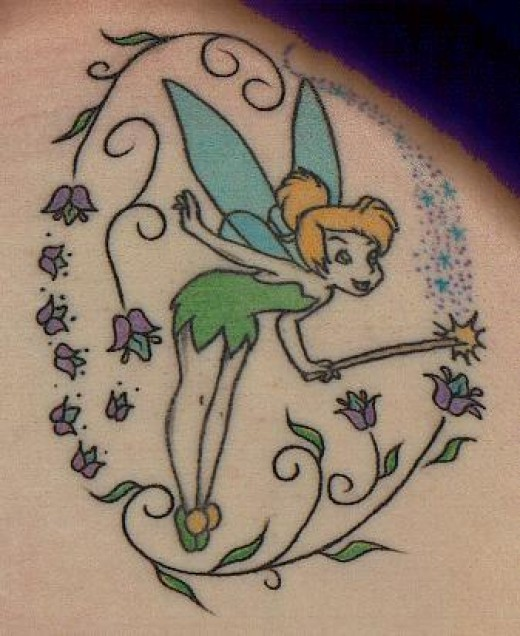 I loves this shoulderblade fairy tattoo. Ok hands up if ya know who that