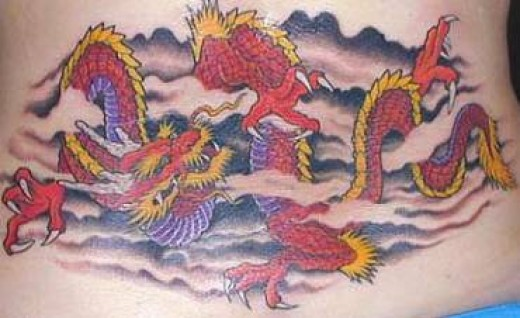 Ok you my loyal readers have made me feel a bit guilty about the dragon tattoos so what about this stunning red dragon lower back tattoo. I deff love this one, something sexy about a dragon.