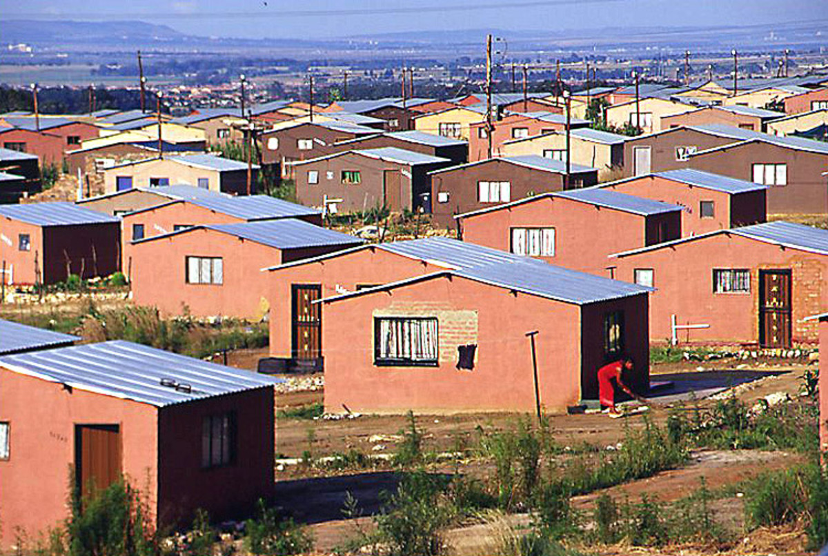 RDP houses that are being built by the ANC in place of shacks; the residents are complaining that the houses are crumbling down on the,