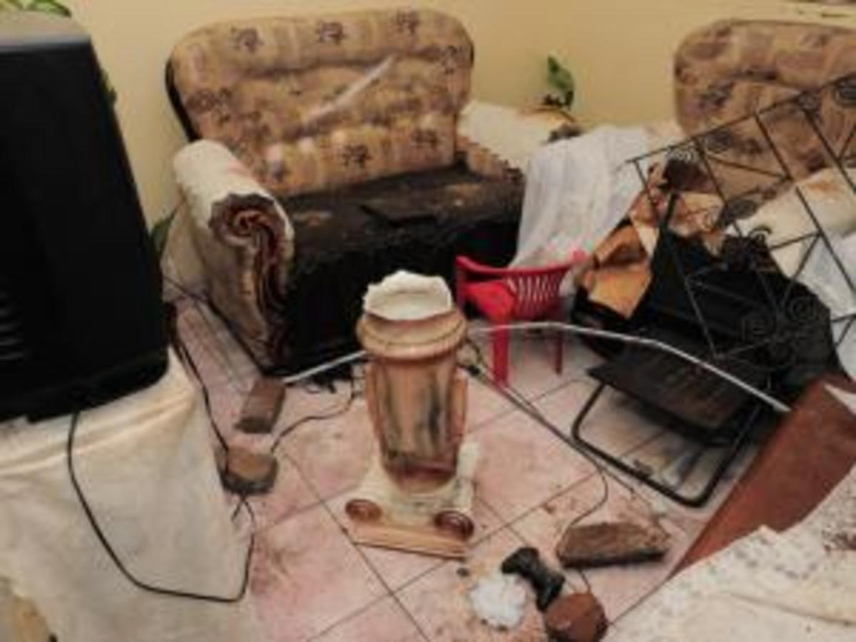 Rocks and bricks lie inside a house in Chiawelo, Soweto, which belongs to a former ward councillor. The house was stoned and her car was burned by an enraged mob who do not want metered electricity boxes in their houses