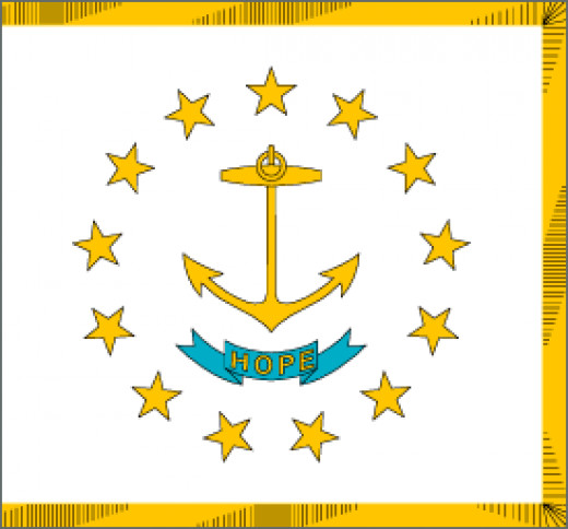 """Rhode Island State Flag Placed on a white field is a circle of thirteen gold stars representing the first thirteen states. The stars surround a gold ship's anchor. The states motto """" Hope"""" is on a blue ribbon below the anchor."""