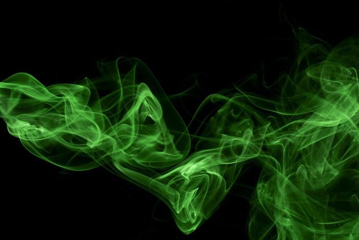 Fotobehang Abstract groen gekleurde rook zwarte