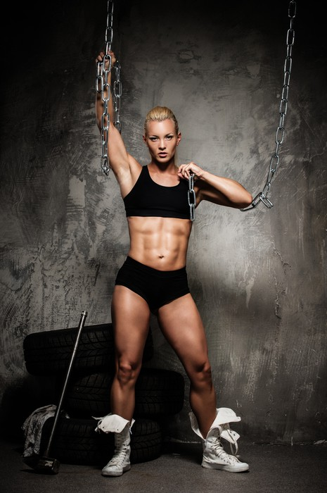 Fotobehang Mooie gespierde bodybuilder vrouw  Pixers