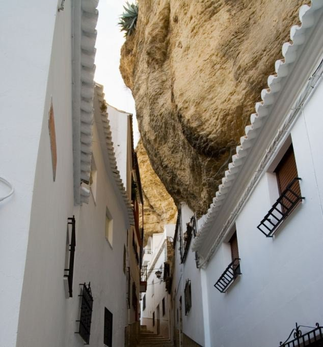 This Gorgeous Spanish Town Built Under A Mountain Needs To