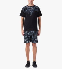 Marcelo Burlon Black/Blue Snake Print Allover Sweatshorts Model Picture