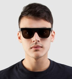 SUPER BY RETROSUPERFUTURE Flat Top Black Leather Sunglasses Model Picture