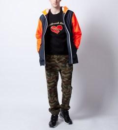 RAINS Blue Orange W Jacket Ltd  Model Picture