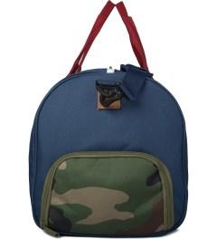 Herschel Supply Co. Navy/Red/Woodland Camo Novel Duffle Bag Model Picture