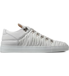 Filling Pieces Off White Wrinkled Leather Mountain Cut Shoes Picture