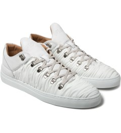 Filling Pieces Off White Wrinkled Leather Mountain Cut Shoes Model Picture