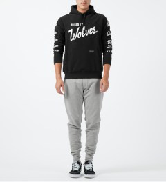 Raised by Wolves Black Varsity Pullover hoodie Model Picture