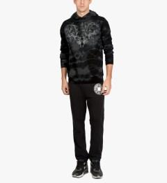 Raised by Wolves Black Tie-dye Wolfpack Pullover Hoodie Model Picture