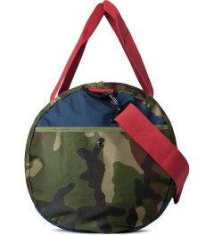 Herschel Supply Co. Woodland Camo/Navy/Red Sutton Duffle Bag Model Picture