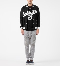 Undefeated Black Script Varsity Jacket Model Picture