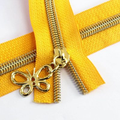 5-Nylon-Coil-Zipper-sunflower-yellow-with-gold-teeth