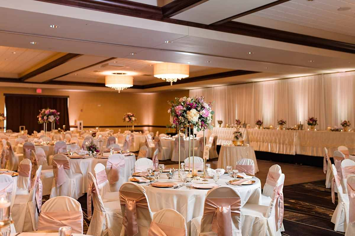 west des Moines ballroom wedding with pink accents peonies and gold chargers