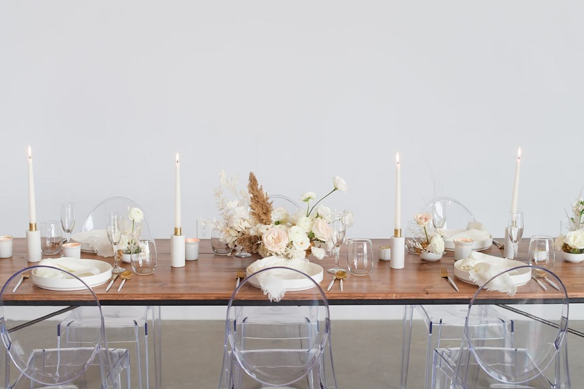 ghost chairs with mod boho white table setting