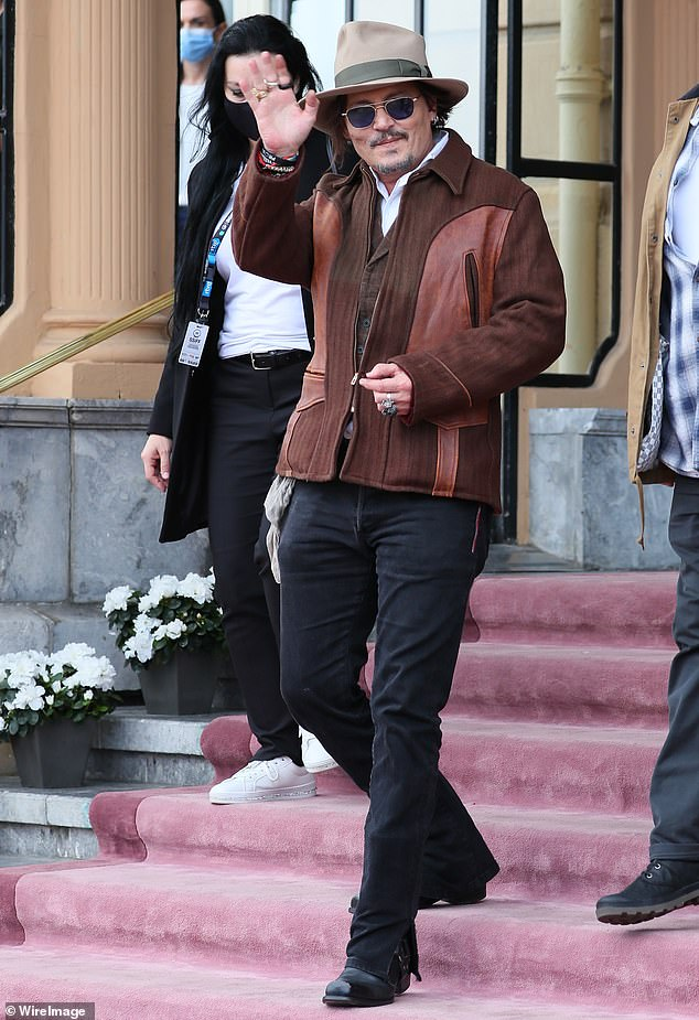 Cheerful:Johnny Depp appeared upbeat on Thursday as he emerged from his San Sebastián hotel after claiming his career has been harmed by the spread of cancel culture.