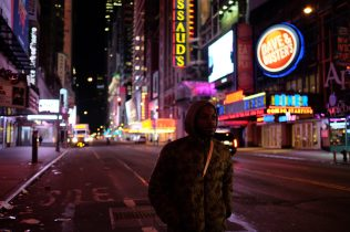 Times Square New York, NY Oct. 12, 2014 Harris walks down a deserted 42nd street on his way to the A train. Photo by M.B. Elian