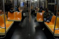 Bronx, NY Oct. 12, 2014 Travis, right, on the late night train home with other passengers Photo by M.B. Elian