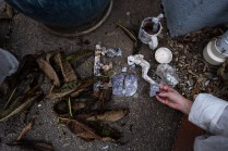Rose looks at some of the few belongings she and her sister found while searching through the rubble of their home that burnt down in the Woolsey fire, Malibu, CA.