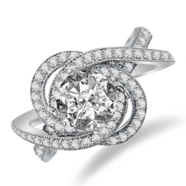 Forever One Moissanite & Diamond Swirl Halo Engagement