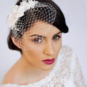 small birdcage veil with cherry