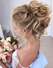 beautiful loose high bun wedding