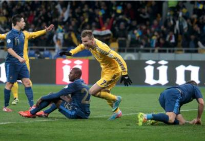 Ukraine's Andriy Yarmolenko celebrates a goal scored by his team mate Roman Zozulya during their 2014 World Cup qualifying first leg playoff soccer match against France at the Olympic stadium in Kiev