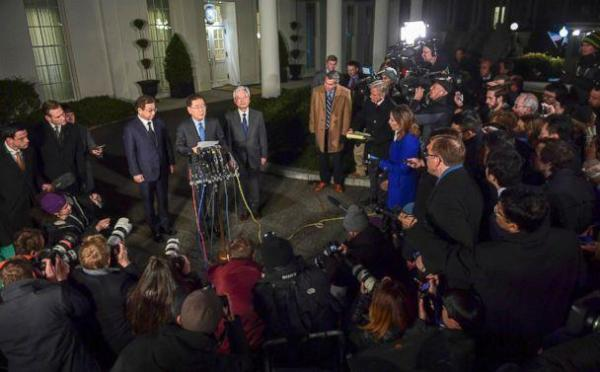 PHOTO: South Korean national security director Chung Eui-yong, center, speaks to reporters at the White House in Washington, March 8, 2018. Intelligence chief Suh Hoon is at left. (Susan Walsh/AP Photo)
